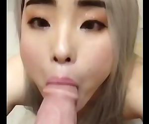 young asian wife sucks on a..